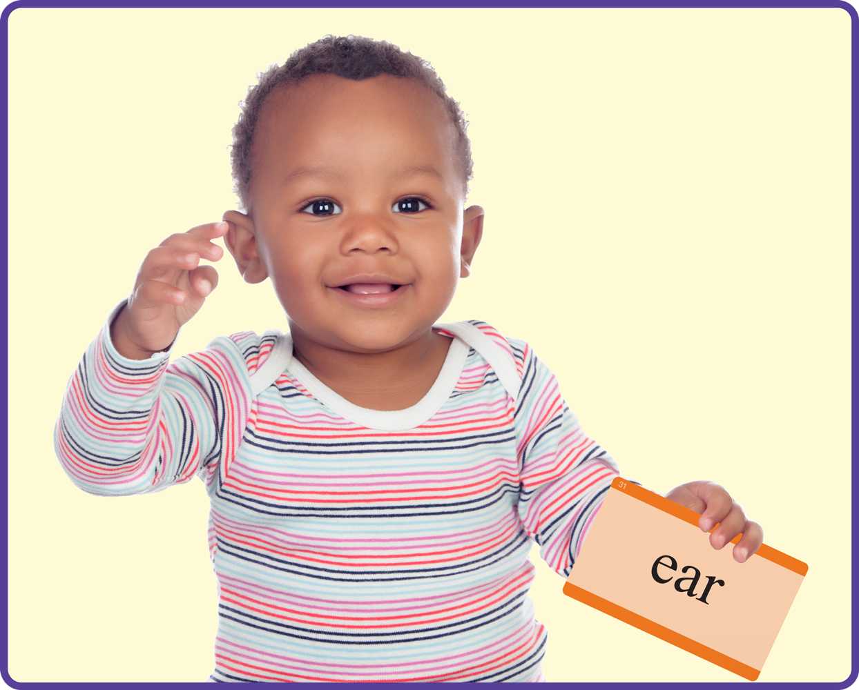 Child holding word card